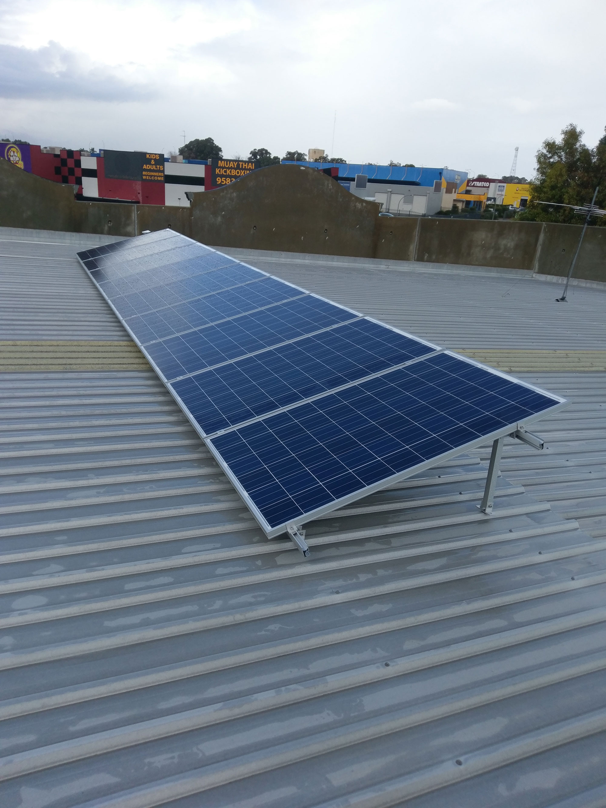 Small renewable energy system on roof of Baby Clothes Warehouse